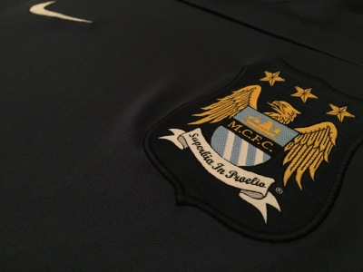 Manchester City FC crest on training shirt 2013/14